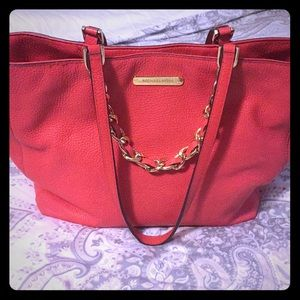 Authentic Michael Kors purse in coral
